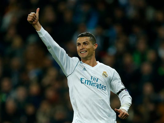 Real Madrid's Cristiano Ronaldo celebratesafter he scored his side's second goal during the Champions League Group H soccer match between Real Madrid and Borussia Dortmund at the Santiago Bernabeu stadium in Madrid, Spain, Wednesday, Dec. 6, 2017. (AP Photo/Paul White)