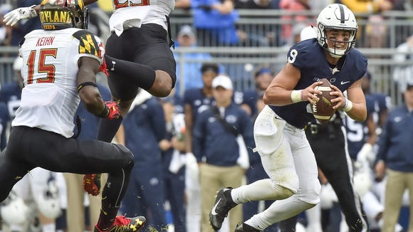 Maryland's Melvin Keihn(15) and Jermaine Carter Jr. (23) pressure Penn States quarterback Trace McSorley (9) during the fourth quarter of a NCAA Division I college football game on Saturday, Oct. 8, 2016, at Beaver Stadium. Penn State defeated Maryland 34-14.