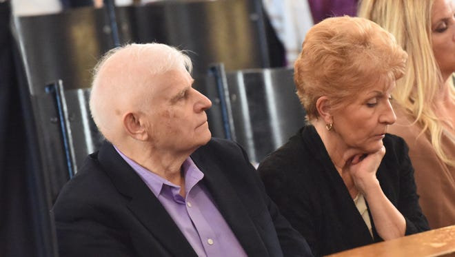 Elizabeth Hrymoc and her husband, Tad, watch the court proceedings on Dec. 7. Elizabeth Hrymoc is suing Johnson & Johnson and its subsidiary, Ethicon, the maker of two pelvic mesh devices that she had implanted in 2008.