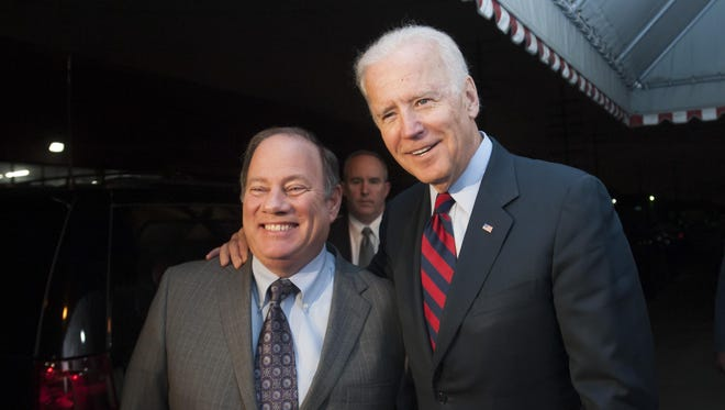 Vice President Joe Biden and Detroit Mayor Mike Duggan talk to the media after eating dinner at Cafe Roma in Detroit on January 15, 2014