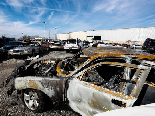 A burned out stolen Dodge Charger sits in the Memphis Police Department's impound lot on Klinke Ave. Earlier this week, a body was discovered inside a van 49 days after the vehicle was impounded. MPD has launched an internal investigation into the matter.