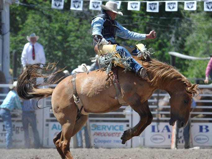 Sylvan La Cross of Baker competes in bareback riding at the Augusta Rodeo on Sunday, June 29, 2014.