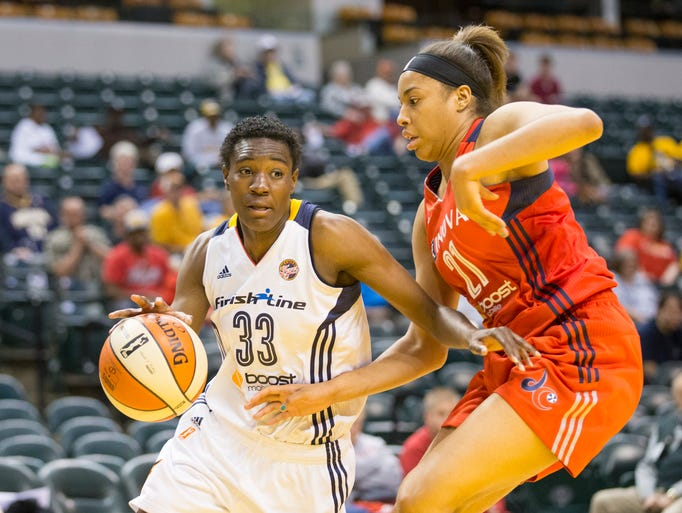 Natasha Howard of the Fever, works against defense by Tianna Hawkins of the Washington Mystics at Indiana Fever, pre season action, Bankers Life Fieldhouse, Indiannapolis, Tuesday, May 6, 2014. Washington won 80-63.