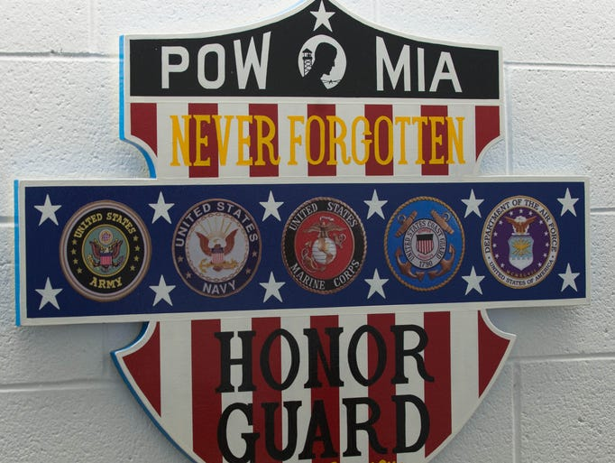 A plaque on the wall in the Honor Guard Building at Fort Custer National Cemetery.