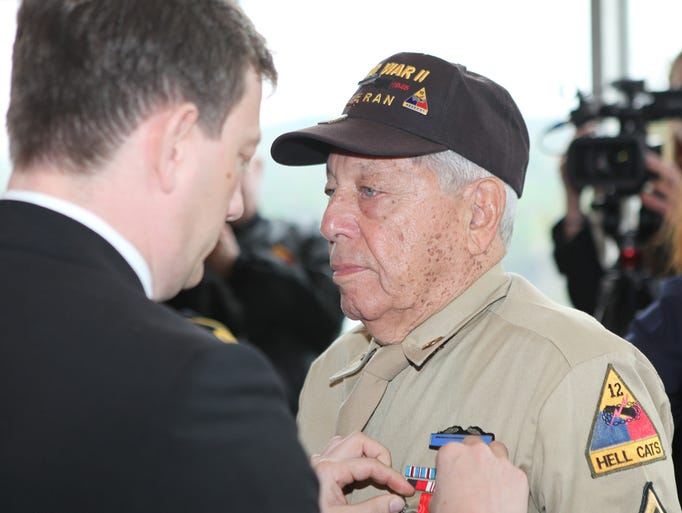 John E. Monaco of Yonkers receives the Legion of Honor from Bertrand Lortholary, the Consul General of France in New York, during a ceremony at West Point May 9, 2014. 34 American World War II Veterans received the medal, considered to be one of France's highest honors.