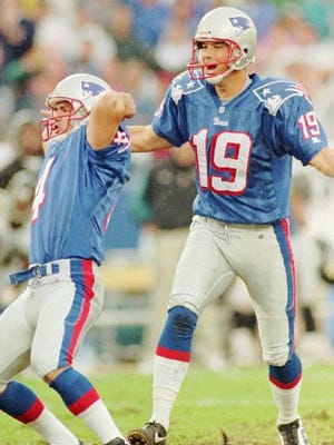 The first game-winner of life, and maybe the most important kick of his life. Adam Vinatieri (left) celebrates with Tom Tupa after he saved his job in Sept. 1996.