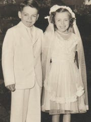 Donnie Walsh with his sister in a childhood photograph.