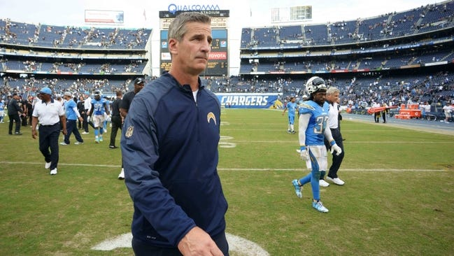 Former San Diego Chargers offensive coordinator Frank Reich walks off the field after the Chargers lost to the Oakland Raiders, 39-27, at Qualcomm Stadium on Oct. 25. Reich was fired Monday.