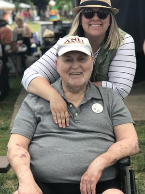 Julee Cobb spends time with her father, Joseph Cobb, during the Smoky Hill River Festival last year. Julee Cobb was named the 2020 Dwayne Smith Caregiver of the Year for the Central & Western Kansas Chapter of the Alzheimer's Association.