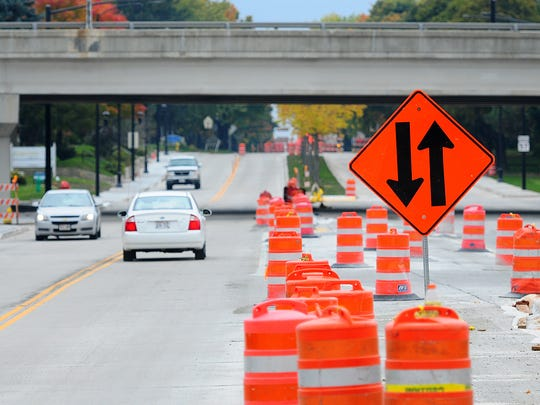 Motorists travel on a portion of S. Monroe Avenue, between Cass Street and Chicago Street on Monday.