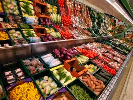 A customer selects vegetables at a supermarket in Prague. Photo: REUTERS/David W Cerny