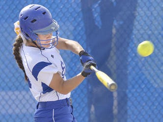 Ripping a line drive during a 2014 contest is Salem's Kara Hutchison. The junior catcher will be instrumental to the 2015 team's fortunes.