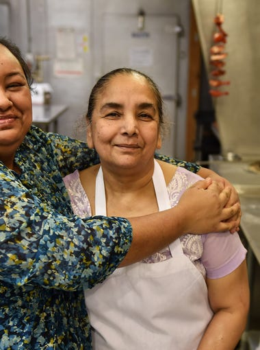 Kulwinder Kaur, who manages Phulkari Punjabi KItchen on Dequindre Road in Madison Heights, left, poses with her mother, Narinder Kaur, who started the family business.  Dequindre between 11 and 17 Mile is a street of family businesses, where food can be the bridge between the Old World and the new.