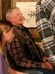 Jack Stevens (center) and his great granddaughter,