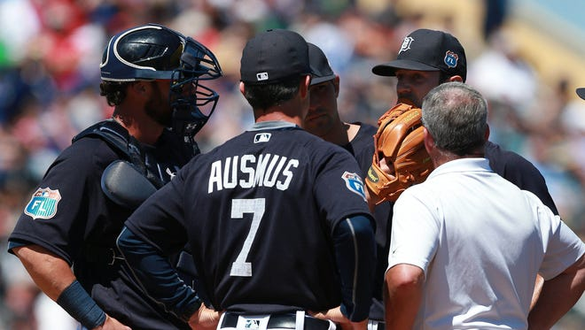 Mar 22, 2016; Lakeland, FL, USA; Detroit Tigers starting pitcher Daniel Norris (44) was with manager Brad Ausmus (7) and trainer Kevin Rand on the mound during the first inning and is taken out with an apparent injury against the Toronto Blue Jays at Joker Marchant Stadium.