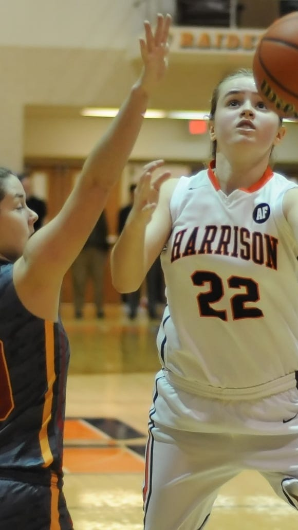 Harrison freshman Sydney Jacobsen drives the lane against