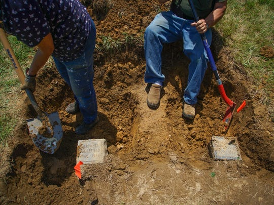 An older couple, who did not want to be identified, have been digging up four dogs that they had buried over the years in the Delaware SPCA Stanton pet cemetery. So far, they have only been able to find three of the dogs.