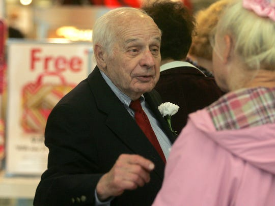 Albert Boscov, who has just stepped down as CEO of the namesake retailer, talks with customer Helga Schuette of Eatontown at Monmouth Mall in this 2011 file photo.