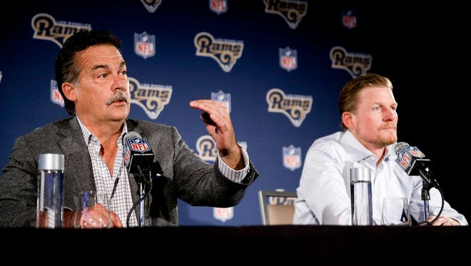 In this April 26, 2016, file photo, Los Angeles Rams general manager Les Snead, right, listens as head coach Jeff Fisher talks about their draft process during a news conference in Los Angeles. Fisher and Snead dismissed widespread speculation about the health of their partnership Friday, claiming they work together closely and professionally.