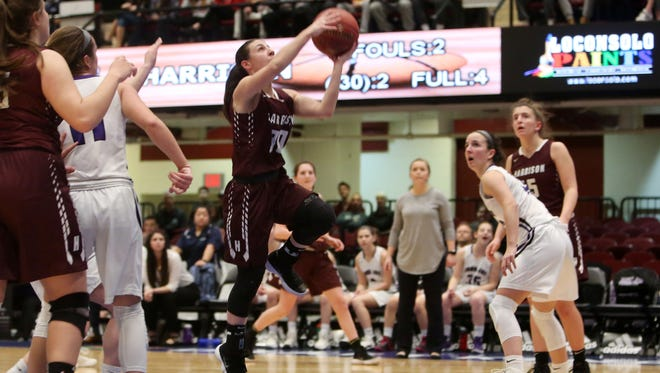 Harrison's Gina Nuvoloni (30) drives to the basket against John Jay (CR) during the girls Section 1 semifinal action at the Westchester County Center in White Plains Feb. 27, 2018.