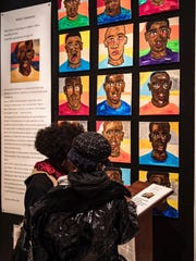 """Nashville artist Lindsay Griffin's exhibit entitled, """"Take a Knee: Protecting Our Nation's Black Sons from Police,"""" is currently on display in Nashville's """"O"""" Gallery."""