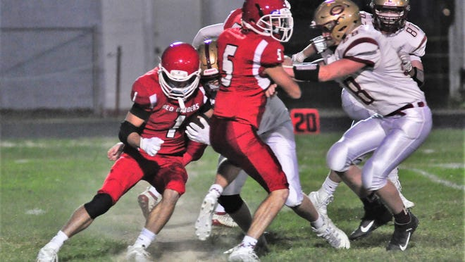 Spaulding tailback Kevin Casey, left, follows the block of Bryan Casey during D-I action Friday night against Portsmouth. Spaulding won, 14-13.