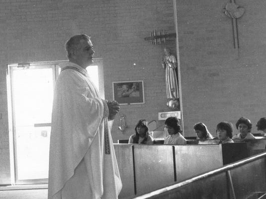 Monsignor James Lindenmeyer is pictured in an undated file photo at St. Mary's Catholic Church in Farmington.  Lindenmeyer served the Farmington parish from 1976 to 1996. Joseph Baca, a sexual abuse victim, alleges that Lindenmeyer intimidated him in order to keep him silent about the abuse in Winslow, Ariz.