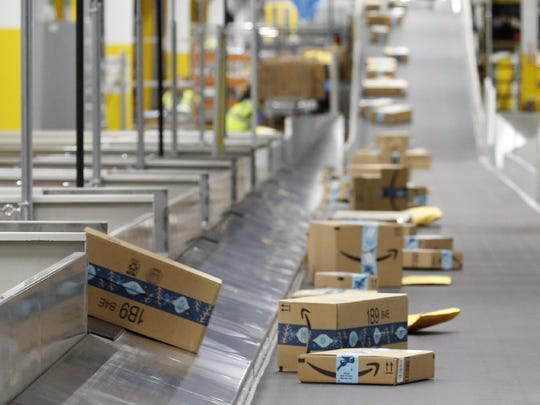 In this December 2019 file photo, Amazon packages move along a conveyor at an Amazon warehouse facility in Goodyear, Arizona. An Amazon delivery station is expected to open in Gainesville at 2121 NW 67th Place by the end of 2020.