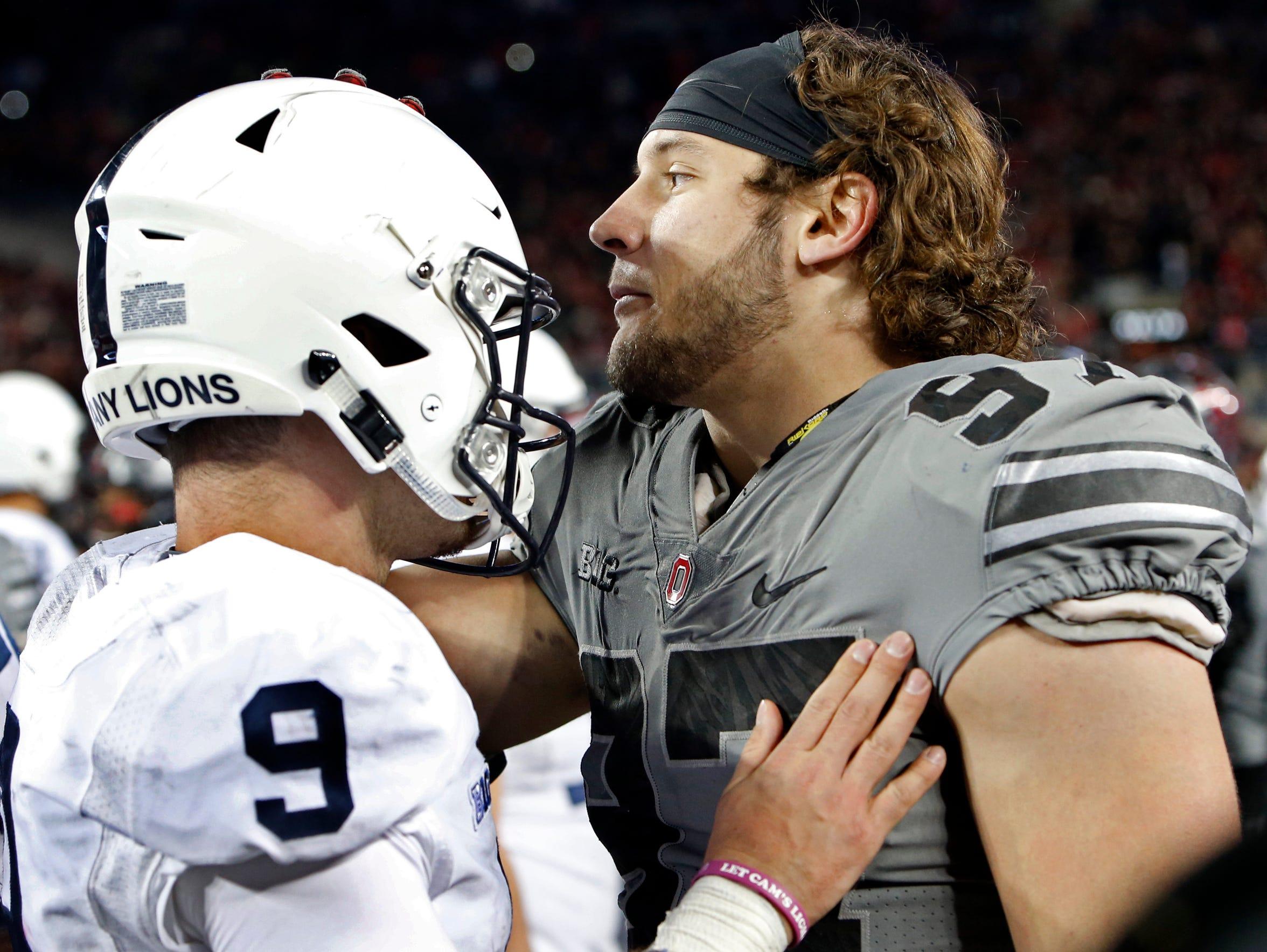 Penn State quarterback Trace McSorley congratulates
