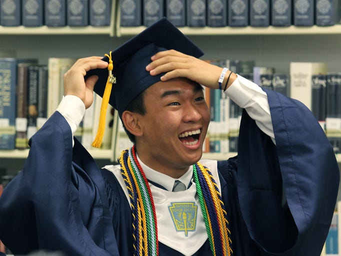Canterbury School graduate Derek Wu reacts while watching a video on display at the media center before his graduation ceremony on Friday.