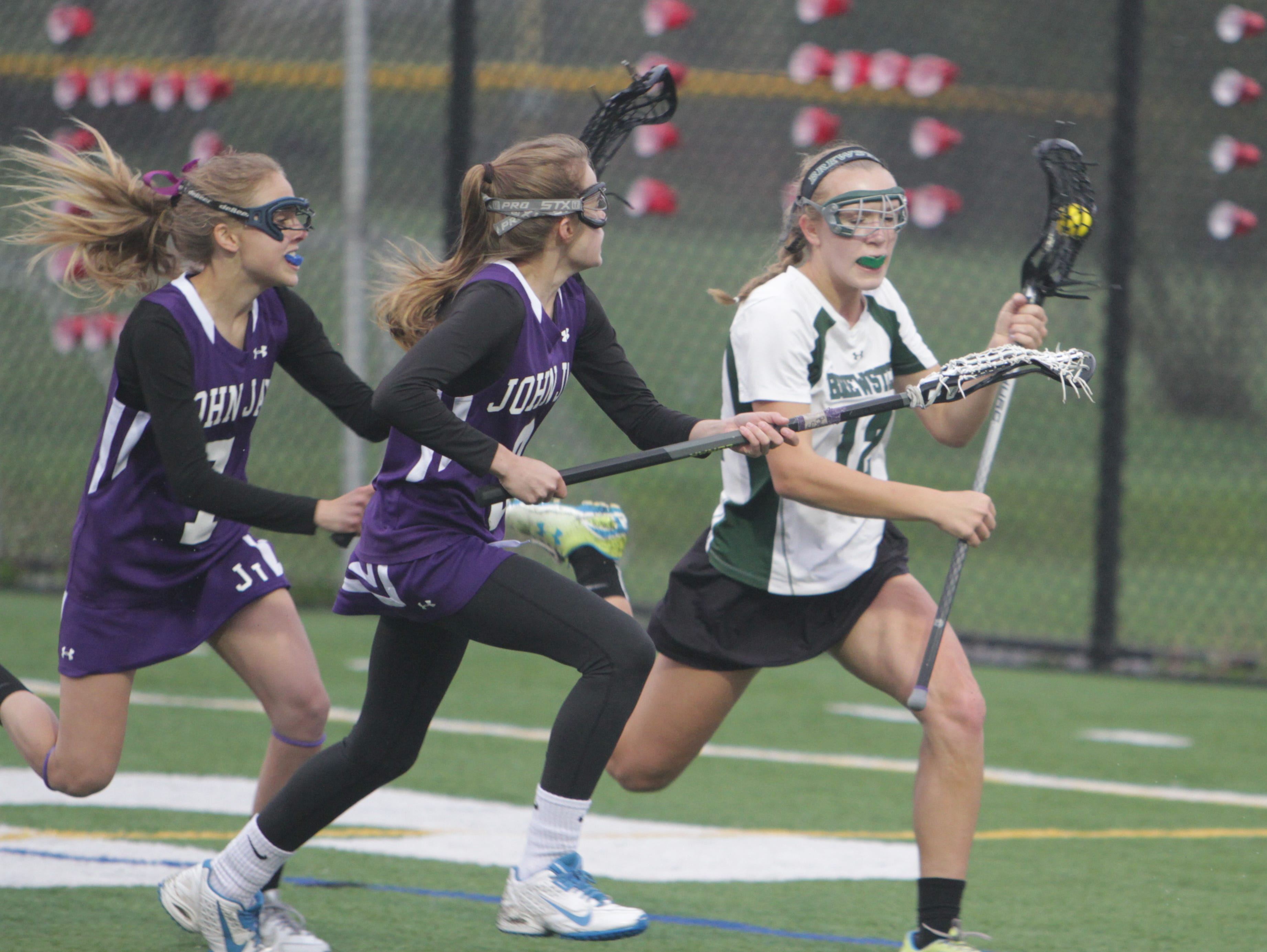 Action between Brewster and John Jay during a girls lacrosse game at Brewster on Friday, May 6th, 2016. John Jay won 9-6.