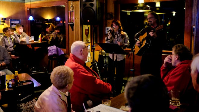 "Jenna Reed and Mike Mercatante perform the song ""Money is a Shelter"" during the Bootlegger Balladeer poetry and song writing contest Wednesday at LaCroix's Riverside Pub in St. Clair."