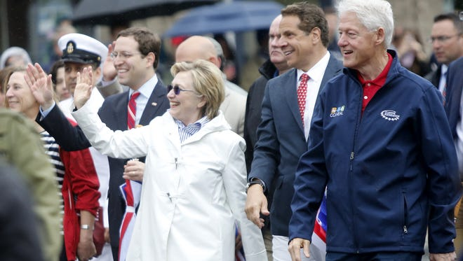 Former Secretary of State Hillary Clinton, New York State Governor Andrew Cuomo and former President Bill Clinton marched in the New Castle Memorial Day observance and parade in Chappaqua on May. 29, 2017.