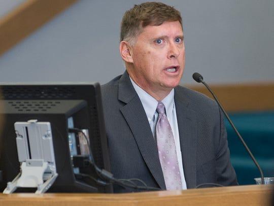 DNA expert Michael J. Spence testifies during the murder