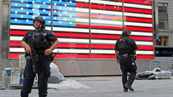 Heavily armed police officers stand guard in the Armed