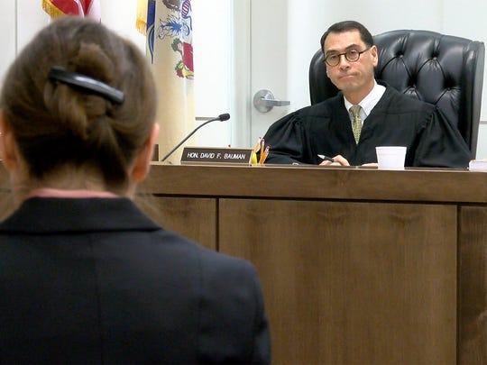 Superior Court Judge David F. Bauman listens to Monmouth