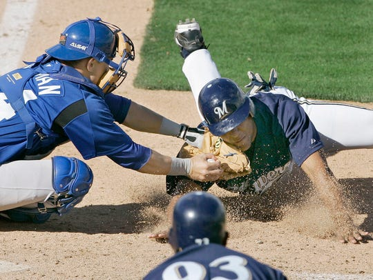 Kansas City Royals catcher Matt Tupman tags out Milwaukee