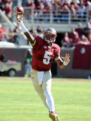 Florida State Seminoles quarterback Jameis Winston (5) throws the ball during the first quarter of the game against the North Carolina State Wolfpack at Doak Campbell Stadium.