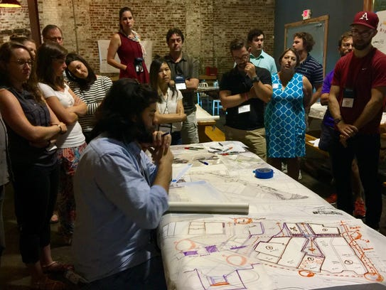 About 25 architects from across Tennessee swarmed the