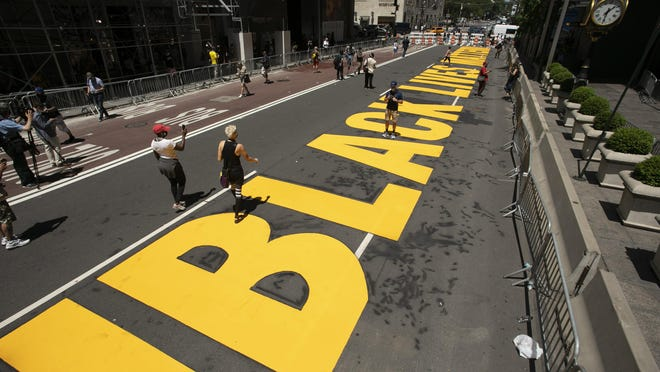 Black Lives Matter is painted on Fifth Avenue in front of Trump Tower, Thursday, July 9, 2020, in New York.