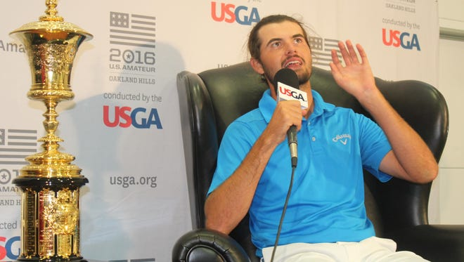 Curtis Luck, accompanied by the coveted Havemeyer Trophy, happily speaks to the media after winning the 116th U.S. Amateur Championship Sunday at Oakland Hills Country Club.