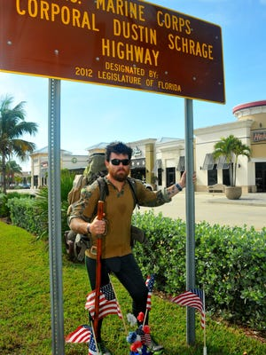 Former Marine Jonathan Hancock is walking from Maryland to California visiting Gold Star families. He was in Brevard over the holiday weekend visiting Preston and Nina Schrage, parents of Marine Corp. Dustin Schrage,  who was killed in Iraq in 12004.  Hancock by the sign on A1A designating that part of A1A as U.S. Marine Corps Corporal Dustin Schrage Highway.