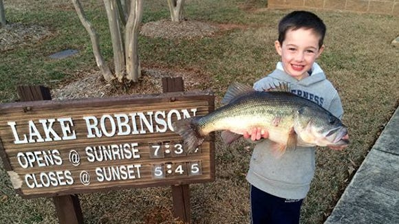 Gavin Hampton, 5, of Travelers Rest holds up the 10-pound