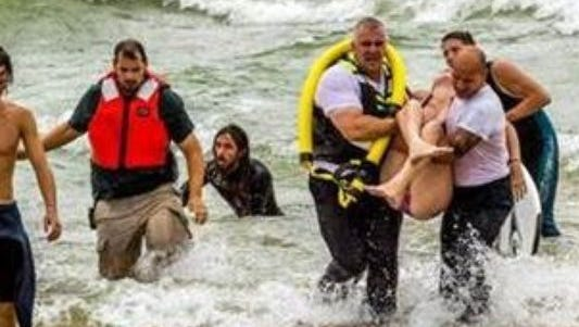 Teen swimmers were rescued from Lake Michigan rip currents in Grand Haven on Aug. 20, 2015.