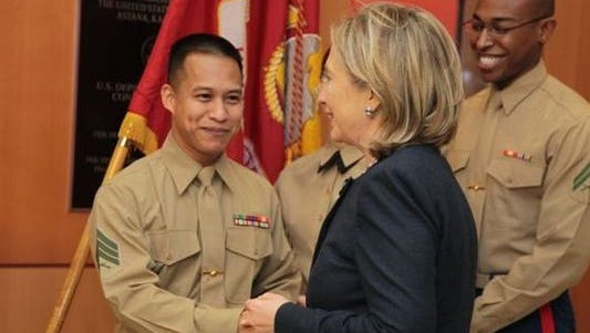 On the campaign trail this week, Democratic presidential hopeful Hillary Rodham Clinton repeated the story that she went to a recruiter's office in the 1970s to inquire about joining the Marine Corps, but was turned down. Here, the former secretary of state meets with Marines at the U.S. Embassy in Kazakhstan in 2010.