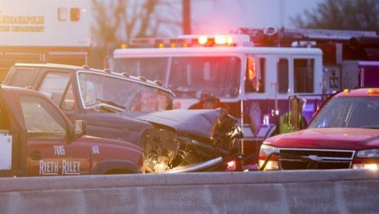 Jordan Stafford's pickup crashed into a sign in a highway work zone on I-69, pushing it forward and killing two construction workers in the accident early May 9, 2014.