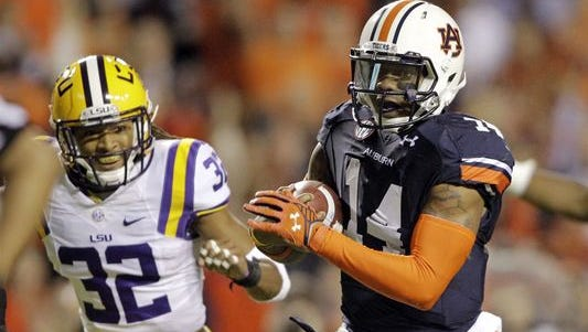 Behind quarterback Nick Marshall (14), Auburn is averaging 262 yards rushing per game.
