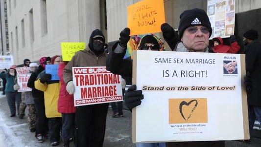 Protesters demonstrate in March outside a federal courthouse in Detroit where Michigan's gay marriage ban was struck down.