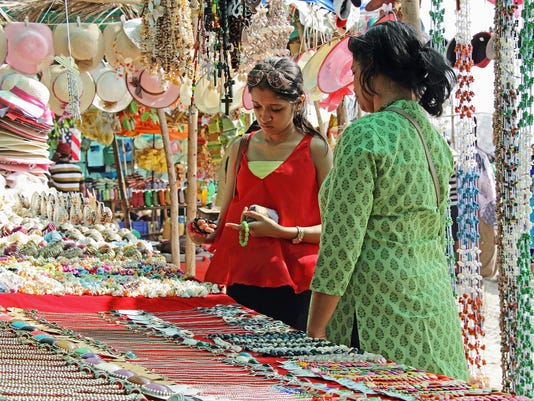 Mother and Daughter Shopping in Flea Market