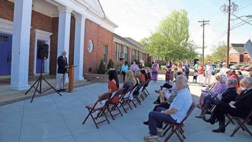 A crowd gathers outside Simpsonville's historic old schoolhouse during a ceremony in which the building earned a South Carolina Historical Marker.
